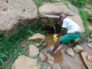 The Water Project:  Pupil Fetching Water