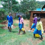 The Water Project: St. Joaim Buyangu Primary School -  Pupils Carrying Water To School