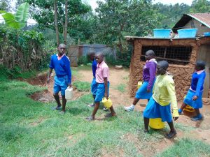 The Water Project:  Pupils Carrying Water To School