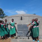 The Water Project: Mwichina Primary School -  Girls Celebrate The Rain Tank