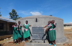 The Water Project:  Girls Celebrate The Rain Tank