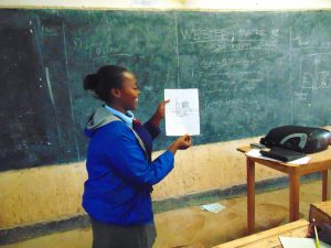 The Water Project:  Pupil Shanice Shows A Poster