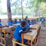 The Water Project: St. Joseph's Lusumu Primary School -  Pupils Taking Notes