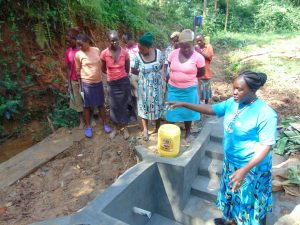 The Water Project:  Learning About The Spring Structure During Construction