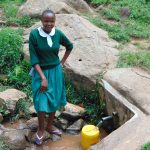 The Water Project: Galona Primary School -  Catherine Waits For Her Container To Fill
