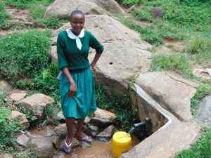The Water Project:  Catherine Waits For Her Container To Fill