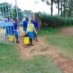 The Water Project: St. Joaim Buyangu Primary School -  Pupils Arrive At School With Water
