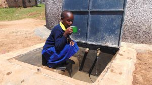 The Water Project:  Enjoying A Fresh Drink From The Rain Tank