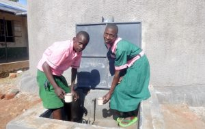 The Water Project:  Students Getting A Fresh Drink From The Rain Tank