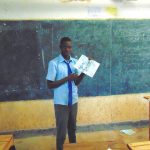 The Water Project: Banja Secondary School -  Pupil Tobias Shows A Poster