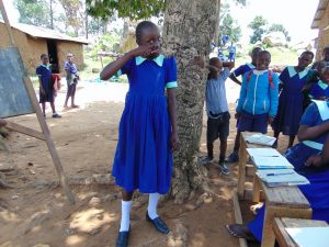 The Water Project:  A Student Demonstrates Toothbrushing