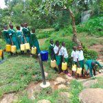 The Water Project: Galona Primary School -  Pupils In Line To Fetch Water