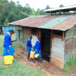 The Water Project: St. Joaim Buyangu Primary School -  Pupils Deliver Water To