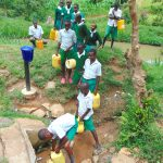 The Water Project: Galona Primary School -  Pupils Fetching Water