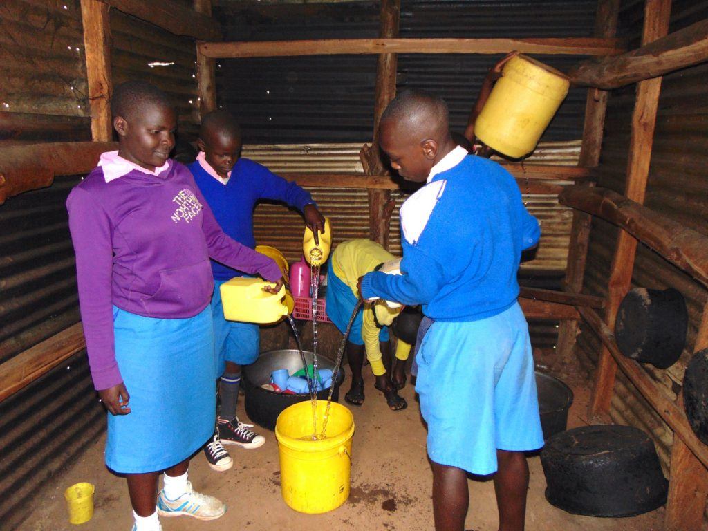 The Water Project : 29-kenya20150-pupils-combine-water-in-kitchen