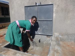 The Water Project:  Student Enjoying The Rain Tank Water