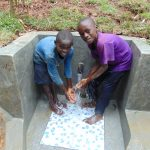 The Water Project: Kisasi Community, Edward Sabwa Spring -  Enjoying The Spring Water