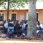 The Water Project: Kitagwa Secondary School -  Students Undertaking Lessons Under A Tree