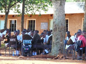The Water Project:  Students Undertaking Lessons Under A Tree