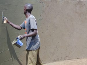 The Water Project:  Plastering Interior Tank Walls