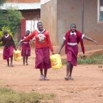 The Water Project: Ebukhuliti Primary School -  Students Carry Water To Construction Site