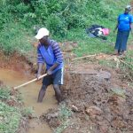 The Water Project: Jivovoli Community, Magumba Spring -  Opening Drainage Channel