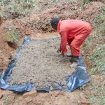The Water Project: Kisasi Community, Edward Sabwa Spring -  Laying The Spring Foundation