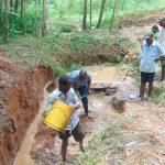The Water Project: Shivembe Community, Murumbi Spring -  Community Members Begin Diverting Water
