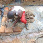 The Water Project: Kimarani Community, Kipsiro Spring -  Bricklaying Begins