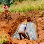 The Water Project: Shikhombero Community, Atondola Spring -  Laying The Foundation