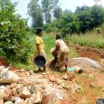 The Water Project: Shikhombero Community, Atondola Spring -  Mama From Community Helps Out