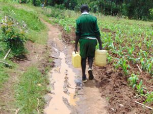 The Water Project:  Pupil Carrying Water