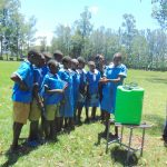 The Water Project: St. Joseph's Lusumu Primary School -  Pupil Demonstrates Handwashing