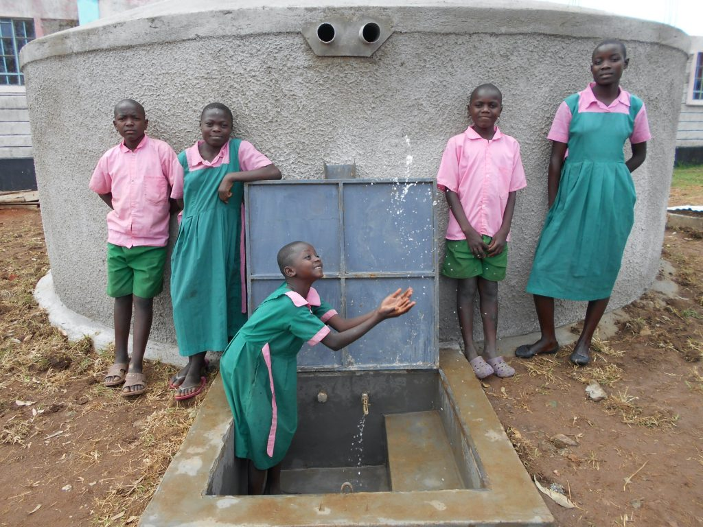 The Water Project : 30-kenya19081-clean-water-flows-from-the-rain-tank