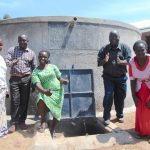 The Water Project: Kosiage Primary School -  School Staff Pose With The Rain Tank