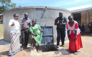 The Water Project:  School Staff Pose With The Rain Tank