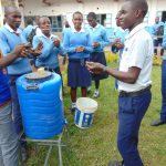 The Water Project: Kamimei Secondary School -  Handwashing Practice With Trainer Samuel