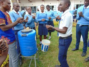 The Water Project:  Handwashing Practice With Trainer Samuel