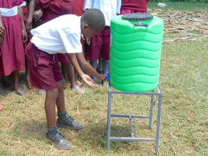 The Water Project:  A Student Washes His Hands