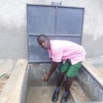 The Water Project: Mwichina Primary School -  Student Enjoying The Fresh Water
