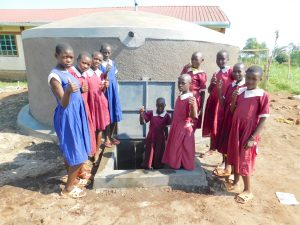 The Water Project:  Girls Pose With The Tank