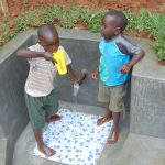 The Water Project: Bumira Community, Imbwaga Spring -  Enjoying A Fresh Drink