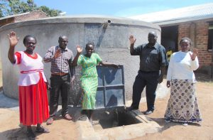 The Water Project:  Staff Wave From Rain Tank