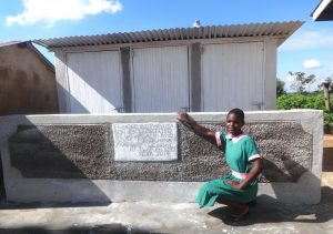 The Water Project:  A Pupil Poses With The New Latrines