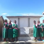 The Water Project: Mwichina Primary School -  Girls Pose With Their New Latrines