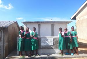 The Water Project:  Girls Pose With Their New Latrines