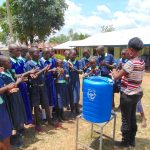 The Water Project: Mukama Primary School -  Learning The Handwashing Steps