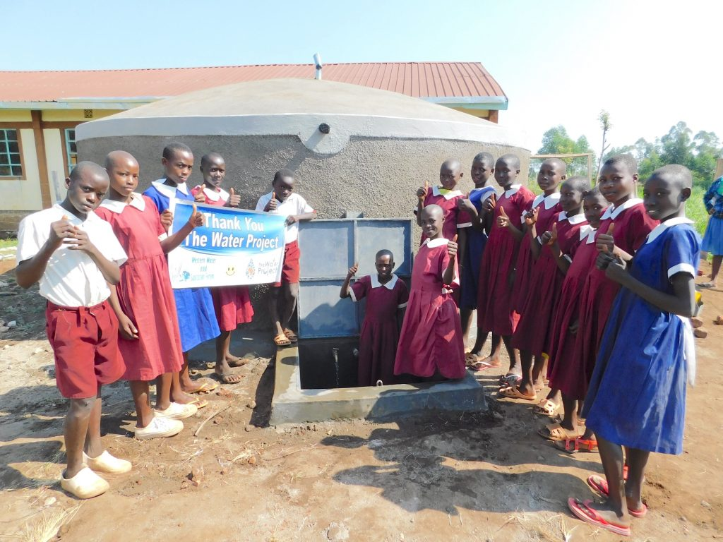 The Water Project : 32-kenya19074-students-pose-with-the-tank