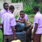 The Water Project: Friends Musiri Secondary School -  Students Combine Water In Storage Drum