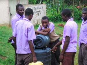 The Water Project:  Students Combine Water In Storage Drum
